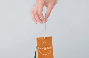 Hand Holding Psd Tag Label Mockup